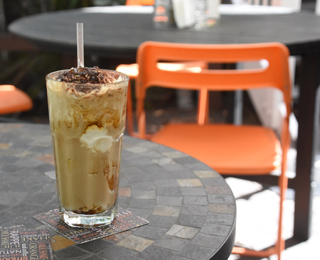Iced Coffee in Cafe Location Stock Photo