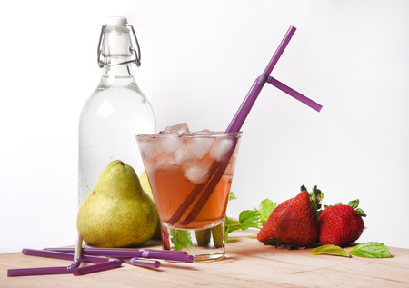 Juice and Strawberries on White Background Stock Photo