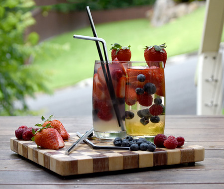 Juice with Black and White Twisted Flexi Straw Stock Photo
