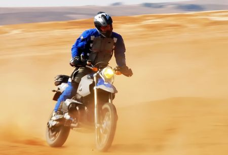 Picture of a man riding a bike on a dirt road Stock Photo - 4468946