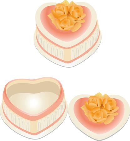 een roze jewel box in de vorm van het hart met bloemen op de cover