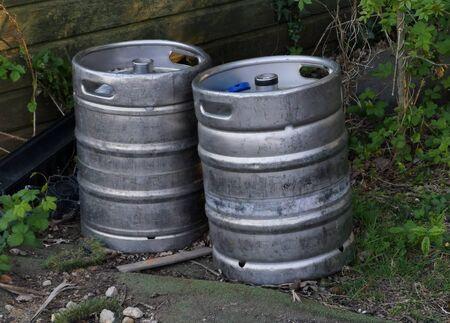A close up of two silver metal barrels Reklamní fotografie