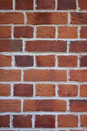 Portrait image of plain terracotta brick work suitable for use as wallpaper