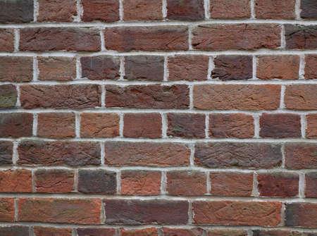 Background of terracotta brickwork in various shades of brown orange