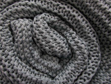 Full frame background image of grey green textured knitting with copyspace