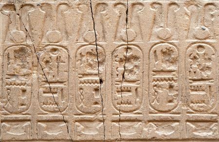 The Egyptian hieroglyphs on a wall of an ancient temple photo