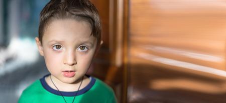 Close up portrait of a surprised european baby boy looking at camera over light background Reklamní fotografie