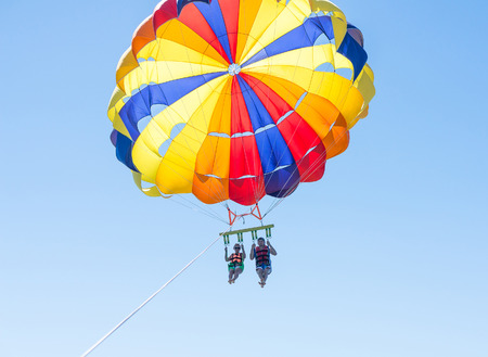Happy couple Parasailing in Dominicana beach in summer.