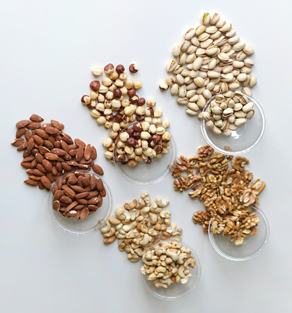 Healthy food. Nuts mix assortment on stone table top view. Collection of different legumes for background image close up nuts, pistachios, almond, cashew nuts, peanut, walnut. image Imagens