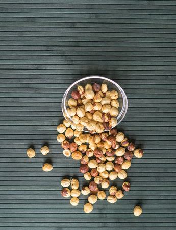 Healthy food  for background image close up hazelnuts.  Nuts texture on top view on the cup plate Imagens