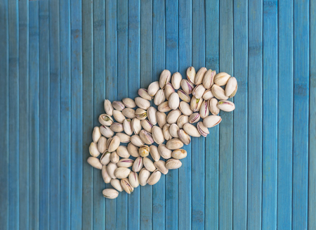 Healthy food  for background image close up pistachios nuts. Texture Nuts on top view mock up pistachio Imagens