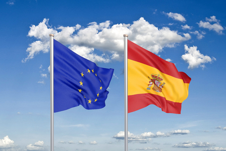 European Union vs Spain. Thick colored silky flags of European Union and Spain. 3D illustration on sky background. - Illustration Stock Photo