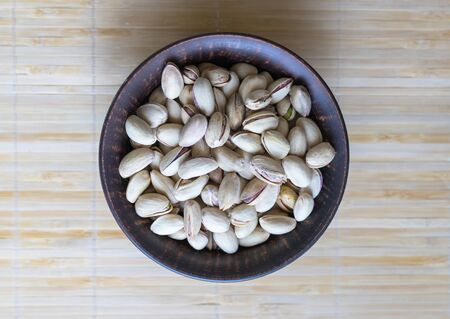 Healthy food  for background image close up pistachios nuts. Texture on top view Nuts pistachio on the cup plate