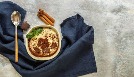 Phirni - sweet rice pudding - traditional Punjabi sweet dish with cinnamon and chocolate. Copy space for recipe or text.