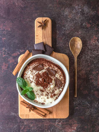Sweet soft pudding made with rice milk, rice flour, and vanilla. Served with chocolate and cinnamon. Gluten-free and lactose-free dessert.