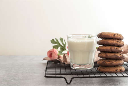Oatmeal chocolate cookies with a glass of milk in the morning. Sweet treats concept with copy space 版權商用圖片