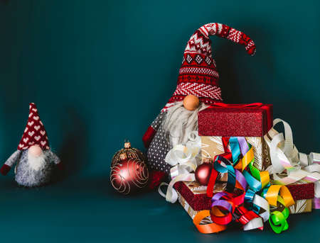 Christmas concept. Winter dwarfs, gift boxes, and decoration with copy space