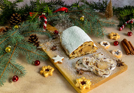 Stollen with marzipan.Traditional German Christmas cake or fruit bread with holiday decorations.