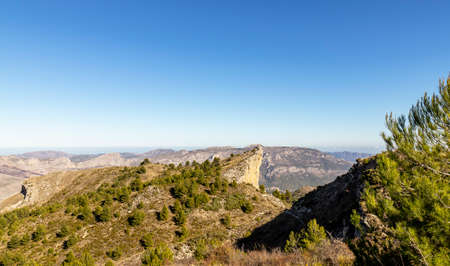 Scenic mountain view of landscape with blue sky. Hiking destination, Aitana mountain massif in Spain.