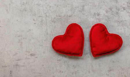 Holiday composition with two hearts on a concrete background. Top view, copy space. Valentines day concept. Zdjęcie Seryjne