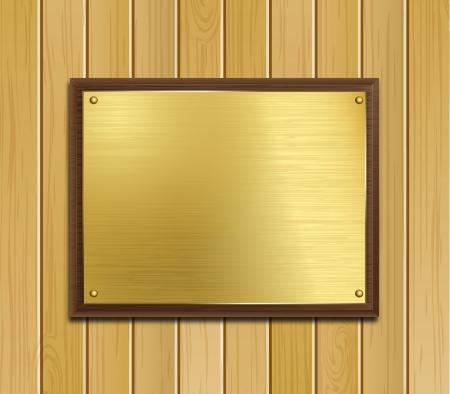 image d'une plaque en laiton monté sur bois sombre assis sur un fond panneau de bois de pin