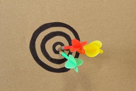 paper board: colorful darts on dartboard