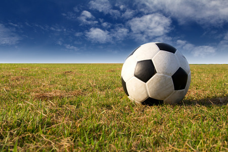 football on field with blue sky Stock Photo