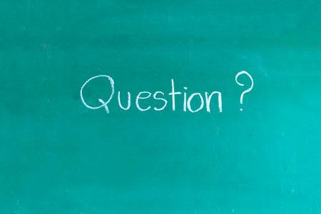 questions: chalkboard with wording Question Stock Photo