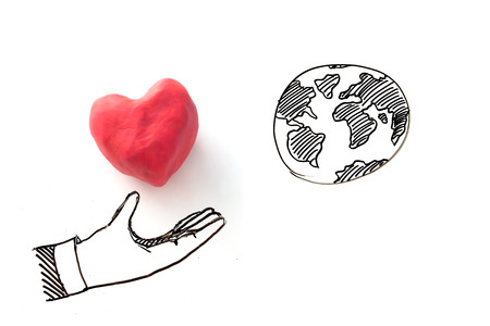 meditation help: Love the world concept , draw of heart in hand reach to the world