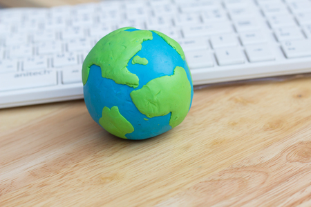 clay modeling: Modeling clay of Globe and notebook on table, communication globalization and network connection concept.