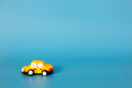 clay modeling: yellow car modeling clay on blue background Stock Photo