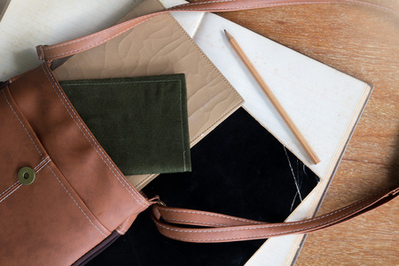 old diary: Old Brown Shoulder bag with pocket book , old diary book , old notebook ,and pencil