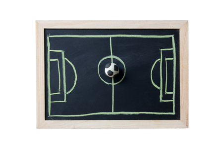 drawing of football field on blackboard with model of ball
