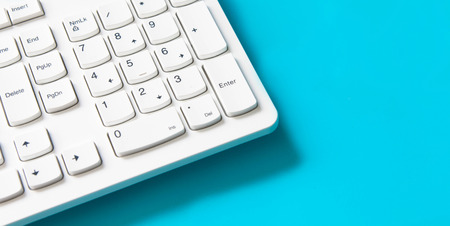 computer keyboard pad on blue background , minimal style