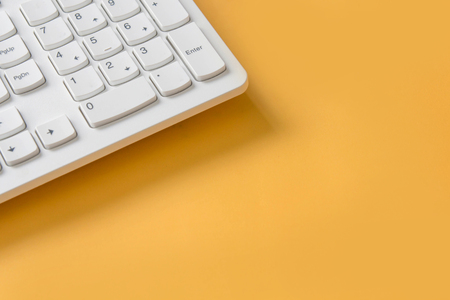 computer keyboard pad on yellow background , minimal style