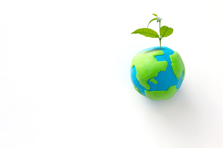 Planting tree in green globe , Environment conservation ,CSR Abbreviation or Corporate Social Responsibility