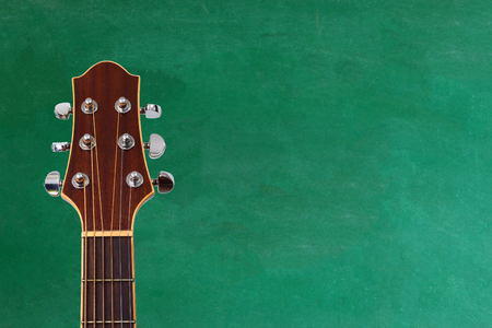 guitar with blackboard on background , concept of music school