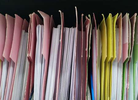 paper document folders in shelf