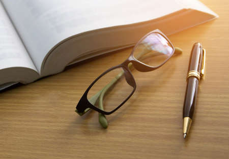 book ,glasses and pen , reading for the exam concept