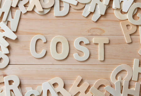 wooden letters with word Cost