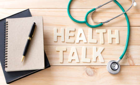 stethoscope and books with wood text  , Health Talk Concept