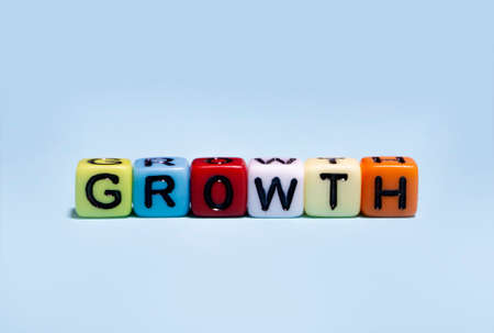 growth , word on many color cube