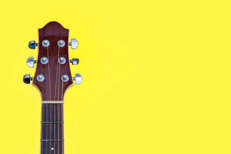 acoustic guitar with yellow background