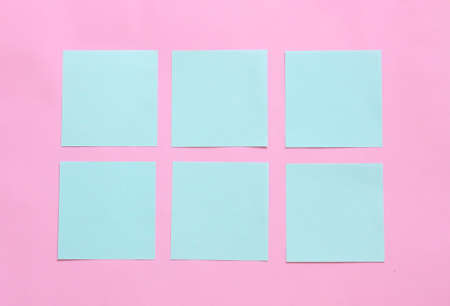 blue pastel sticky note on pink background