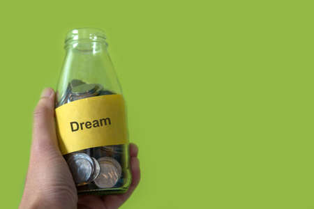 coins in bottle , saving for dream concept