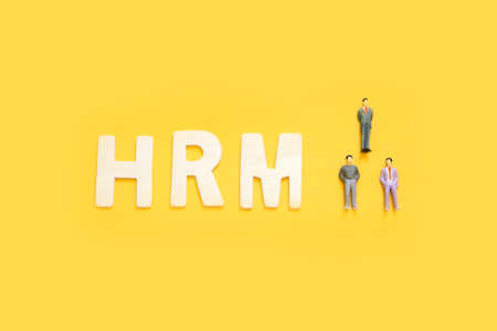 Human Resource Management Concept , small figures of businessman with message HRM