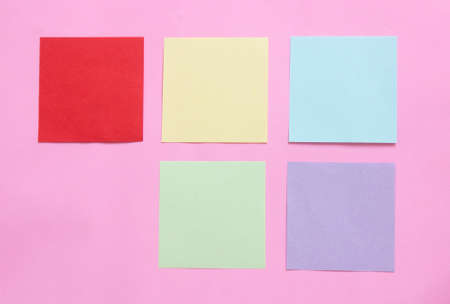 multicolor of sticky note paper on pink background