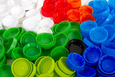 pile of many color of plastic caps, plastic caps for recycle