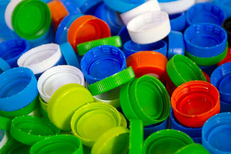 pile of plastic bottle caps , recycle and reduce plastic for the world