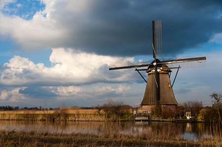water mill: Windmill in Kindeijk, Netherlands with dramatic sky.